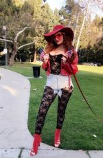 Phoebe Price Poses in multiple ensembles in Beverly Hills