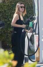 Rachel Bilson Stops to fill the tank of her car while running errands in Los Angeles
