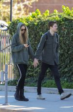 Romee Strijd and Laurens van Leeuwen wear matching outfits during a leisurely stroll in Beverly Hills