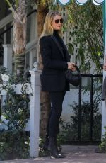 Rosie Huntington-Whiteley Dons her usual black attire for lunch with a friend