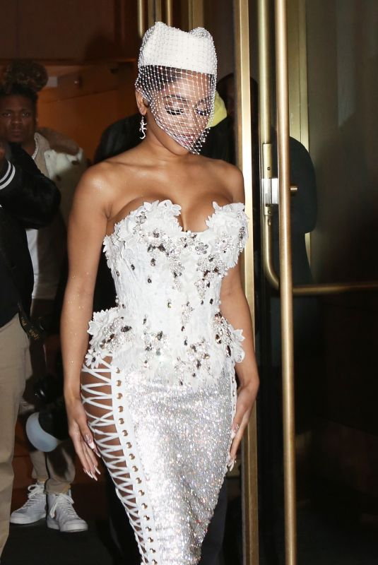 Saweetie Spills out of her sexy white dress as she signs autographs for fans outside her hotel in Manhattan