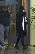 Selena Gomez Steps out in the rain for a gym session before Oscar Night in Hollywood