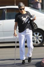 Selma Blair Pumps gas and grabs coffee with the assistance of a glass cane