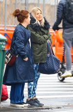 Sienna Miller Does her best to keep warm after a rainy day workout session in New York