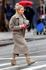 Sienna Miller Shows off her engagement ring as steps out on a rainy morning in NYC