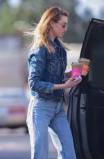 Whitney Port Dons double denim carrying a green puffer jacket and yellow Chanel bag while shopping in Studio City