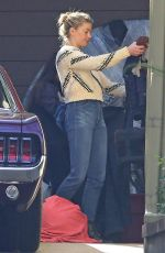 Amber Heard and girlfriend Bianca Butti take a break from quarantine to clean out their garage in Los Angeles