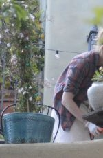 Amber Heard Wearing staained gloves during gardening in Los Angeles
