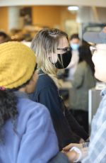 Ashley Benson and Cara Delevingne step out with one of the adorable puppies they are fostering during quarantine