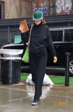 Bella Hadid Steps out in the pouring rain to visit her sister Gigi at her apartment in New York City