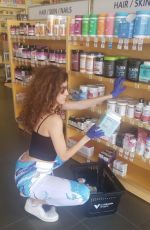 Blanca Blanco Practices her safety with latex gloves as she steps out to grab her vitamins before going back into self-isolation
