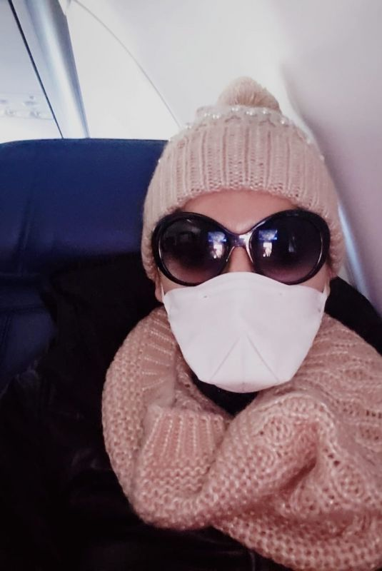 Blanca Blanco Wears mask and gloves while flying to Detroit
