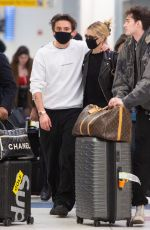 Brooklyn Beckham and girlfriend Nicola Peltz wear matching masks for Coronavirus at JFK Airport in New York City