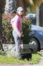 Calista Flockhart Can almost pass as a Professional Dog Walker