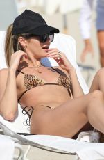 Candice Swanepoel and Lais Ribeiro both wear tiny leopard print bikinis as they hit the beach in Miami