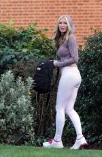 Caprice Bourret Practicing Yoga in a park, London