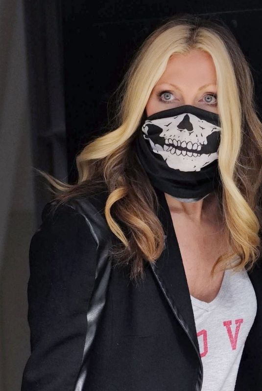 Caprice Bourret Wore a skull face mask as she rushes off to podcast recording in London