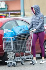 Charlize Theron Shopping in bad weather in West Hollywood