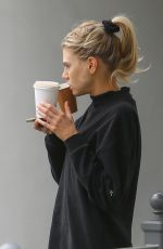 Charlotte McKinney In all black active wear as she grabs her morning coffee