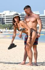 Danielle Lloyd & husband Michael O Neill seem playful on the beach in Dubai
