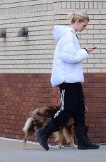 Daphne Groeneveld Ventures out with no mask to walk her dog in NY