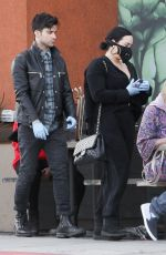 Demi Lovato Wears a mask stocking up on groceries with new boyfriend Max Ehrich