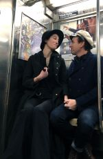 Ewan McGregor and girlfriend Mary Elizabeth Winstead hold hands while riding the NYC Subway