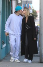 Hailey Bieber & Justin Bieber Look in love as they share a kiss while out for a walk in West Hollywood
