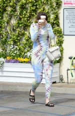 Joey King Hides from the cameras while out getting some coffee in Studio City