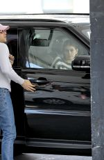 Kaia Gerber Waits in the car as one of her male friend