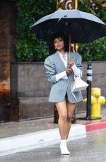 Kat Graham Keeps dry under a umbrella as she leaves the Petit Ermitage hotel in West Hollywood