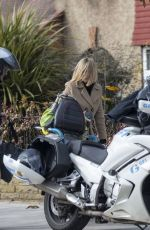 Kate Garraway Pictured arriving home from work on a Motorcycle Taxi