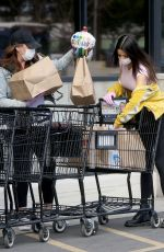 Katie Bell Shops for supplies wearing a protective mask and gloves during the coronavirus outbreak in LA