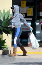 Katy Perry Carries Nugget in her hoodie and protects her hands from touching her shopping bag as she visits CVS Pharmacy in LA