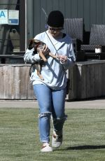 Kelly Osbourne Cradles her dog in her arms while out grabbing take out from popular Kristy