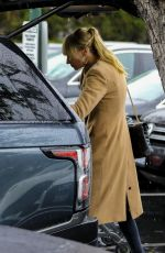 Kimberly Stewart and boyfriend Jesse Shapira go out in the rain to stock up on groceries at Bristol Farms in Beverly Hills