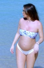 Lauryn Goodman out in the Caribbean sunshine of Barbados with a skimpy little floral Bandeau bikini