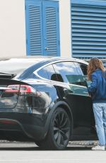 Mila Kunis Exit via the backdoor after a long morning at the DMV in Los Angeles