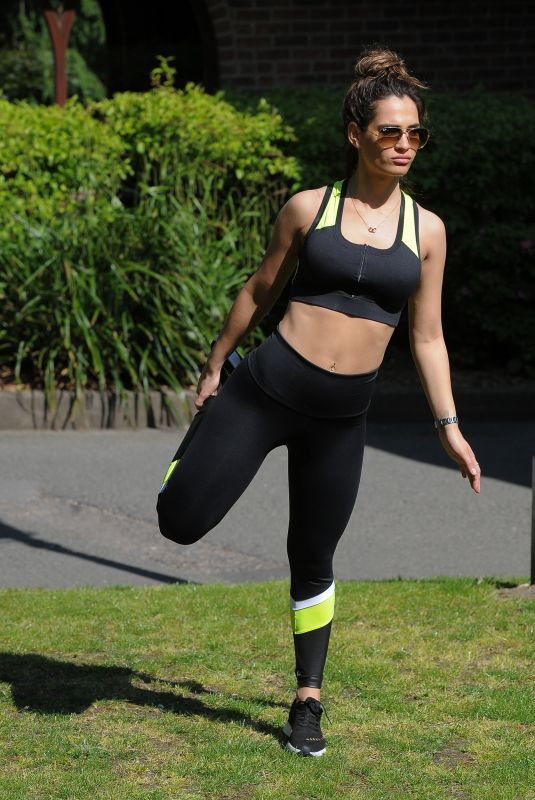 Nicole Bass Doing some stretches outside her house in Essex