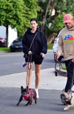Nicole Williams and Larry English walk there pups during corona virus pandemic