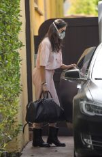 Nina Dobrev Unloads her car after shopping for essentials wearing a surgical mask in Los Angeles