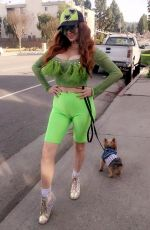 Phoebe Price Poses for photos in a neon green look while out walking her dog in Beverly Hills