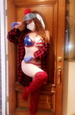 Phoebe Price Poses for photos in an American flag bikini and a mask in West Hollywood