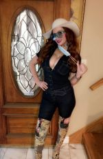 Phoebe Price Poses for photos in her Coronavirus mask at her home in Beverly Hills
