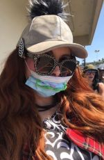 Phoebe Price Wears a mask as she poses for photos while out in West Hollywood during coronavirus pandemic