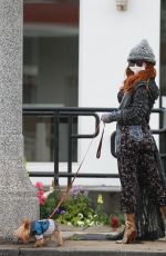 Phoebe Price Wears a mask to protect her from the Coronavirus while walking her dog in Beverly Hills