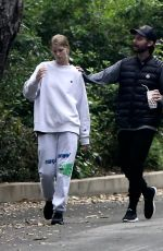 Abby Champion and Patrick Schwarzenegger look like a happy couple as they enjoy a walk in Brentwood