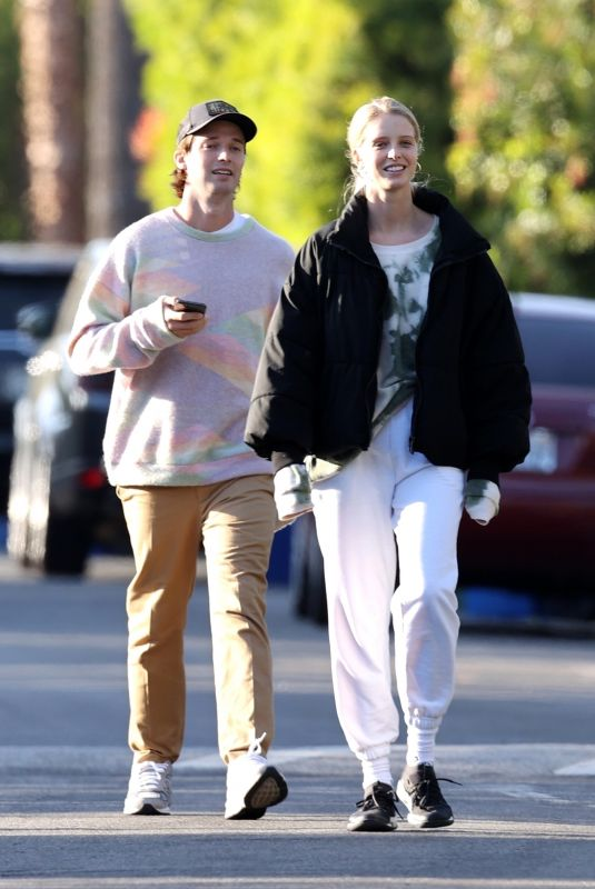 Abby Champion Seen laughing together with a friend while on a walk around Brentwood