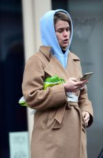 Alice Eve Outside a butcher shop in London
