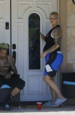 Amber Rose and Alexander Edwards get some fresh air in front of her home during safer at home order